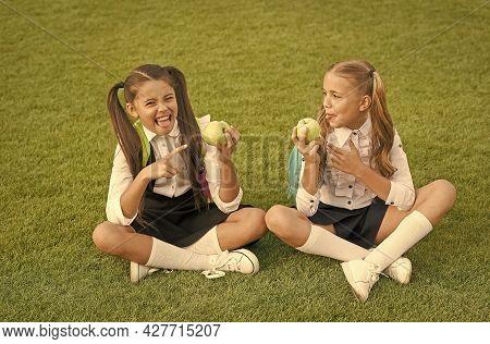Having Taste Of Lemon. Little Girl Point At Sour Apple Fruit. Fruit Acid. Small Children Eat Fruit O