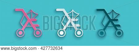 Paper Cut Baby Stroller Icon Isolated On Blue Background. Baby Carriage, Buggy, Pram, Stroller, Whee