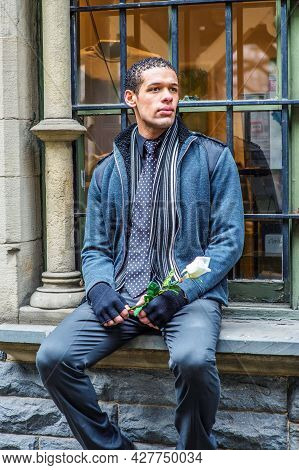 A Young Guy, Holding A White Rose And Sitting On A Window Frame, Is Waiting For You.