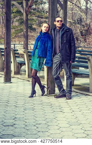 Dressing Heavily A Girl And A Guy Are Met Outside In A Chilling Winter.
