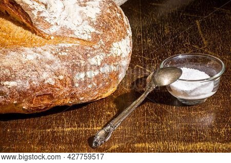 Still Life - Yeast-free Buckwheat Bread With Coarse Salt In Glass Jar, And A Linen Napkin On A Woode