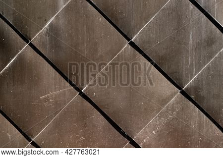 Modern Materials In The Construction Industry. Texture Of Metal Cladding Of A Building Facade Closeu