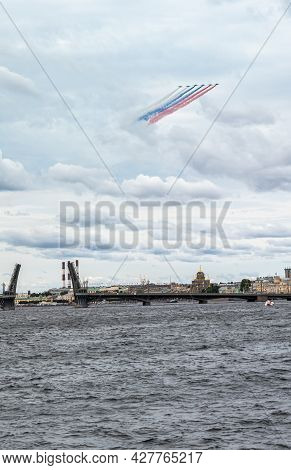 July 22, 2021, Russia, St. Petersburg. Military Aircraft Painted The Sky Over The Neva In The Colors