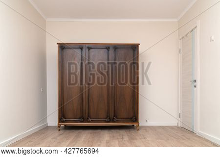 Old Wooden Wardrobe In A Renovated Living Room