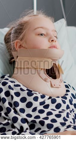 Portrait Of Hospitalized Little Child Wearing Neck Cervical Collar After Suffering Trauma Accident D