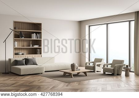 Corner Of Light Beige Living Room. Interior With Panoramic Space, Using Wall Niche With Bookshelf, T