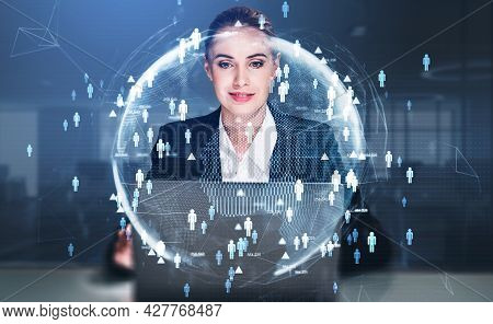 Attractive Businesswoman Sitting At The Table And Working On Laptop Conducting A Research To Hire Hi