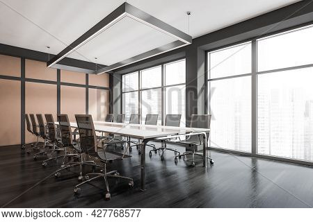 Corner View Of Modern Meeting Room Interior With Dark Wooden Flooring, Pinky Beige Wall With Grey St