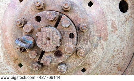 Rusty Tractor Wheel. Technical Background With Corroded Wheel Disc And Hub. Old Tractor Or Heavy Agr