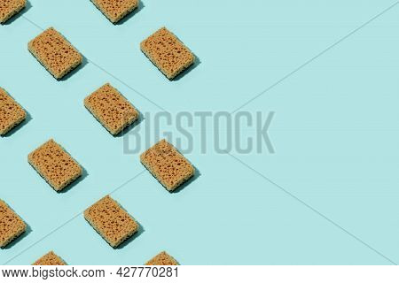 Pattern With Neutral Beige Clean Sponges For Home Cleaning On Blue Background. Banner For Your Site,