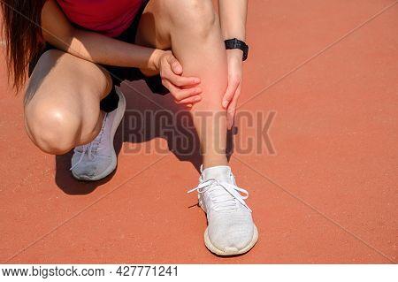 Cropped Shot Of Woman Runner Suffering Pain From Shin Splint. It Often Happens In The Front Or Insid