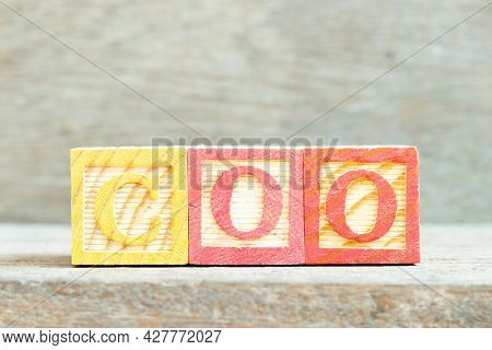 Color Alphabet Letter Block In Word Coo (abbreviation Chief Operating Officer) On Wood Background