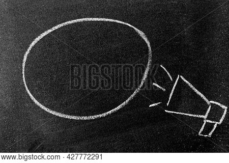White Color Chalk Hand Drawing In Megaphone With Black Round Bubble Banner Shape With Blank Space On