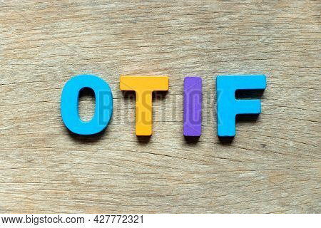 Color Alphabet Letter In Word Otif (abbreviation Of On Time In Full) On Wood Background