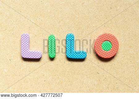 Foam Alphabet Letter In Word Lilo (abbreviation Of Last In Last Out) On Wood Background