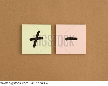 Plus And Minus Signs On Papers. Concept Of Positive And Negative, Pros And Cons. Good Vs Bad Compari
