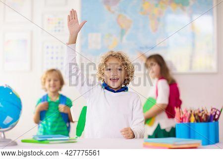 Kids In School. Preschool Children In Class. Happy Kids Back To School. Student In Classroom. Child