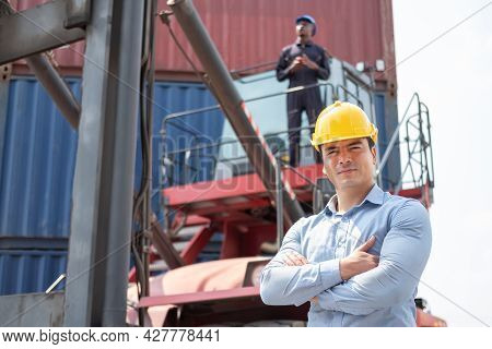 Selective Focus At Caucasian Freight Supervisor Logistic Worker Wearing Safety Equipment, Check And