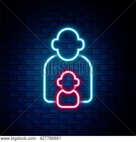 Glowing Neon Line Taking Care Of Children Icon Isolated On Brick Wall Background. Colorful Outline C