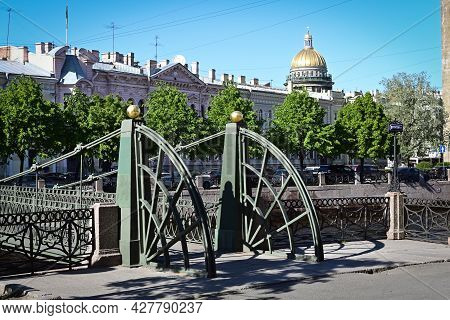 Bridges, Rivers And Architecture Of St. Petersburg. View Of The Pochtamsky Bridge Over The Fontanka