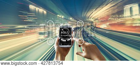 Agile Concept With Person Using A Smartphone Over Abstract High Speed Technology Pov Motion Blur