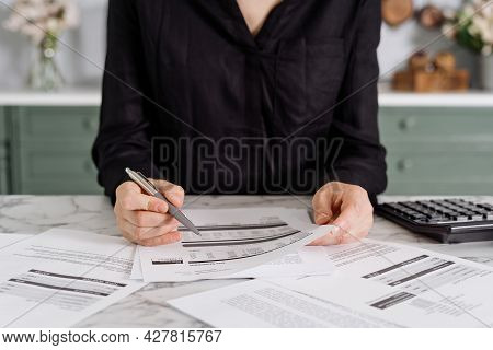 Cropped Photi Of Woman Wearing Black Clothes Calculating Various Expenses, Checking Her Gas Statemen