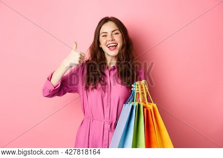 Young Happy Female Shopper Showing Thumbs Up, Pleased With Good Discounts, Buying Staff On Sale, Hol