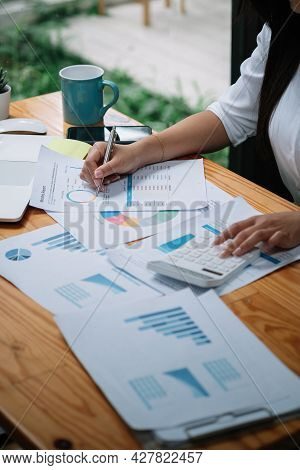 Accountant Woman Hand Press On Calculator For Make Financial Report Or Companys Profit Monthly At De