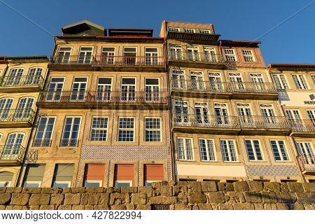 Facades Of The Typical Houses Of Porto In The A Ribeira Zone At Sunset. Porto, Portugal.