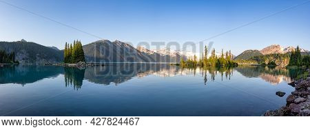Panoramic View Of Canadian Nature Landscape With Rocky Islands And Mountains In The Background. Gari