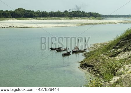 The Small Gorai River With Blue Water And Some Boat Floating On The Water And Surrounded By Greenery