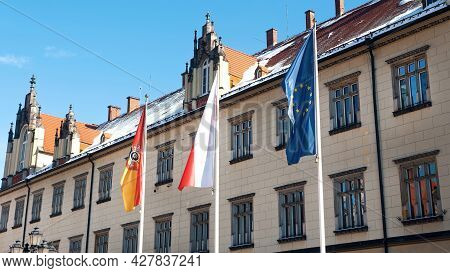Krakow, Poland 03.02.2021 German And European Union Flags Near A Facade Of The Embassy Building In K