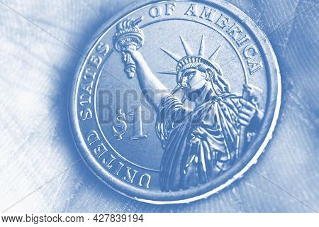 Us Coin Lies On The Palm. 1 One Dollar Coin Close-up. Light Pale Blue Tinted Wallpaper. Economic, Fi