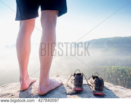 Slim Barefoot Legs With Hairy Calves Of Runner Stay At To Removed Sweaty Running Shoes On A Rocky Ed