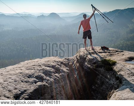 The Photographer Holds A Tripod With A Camera High In The Air And Rejoices In A Beautiful Day. Natur