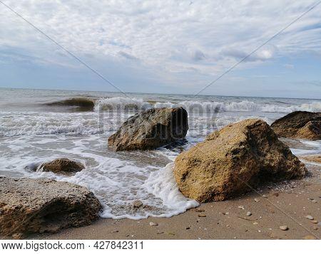 Cliff by the Sea. Sea shore. Steep shores of the Sea.