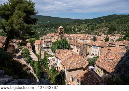 View On Mountains Cliff, Old Houses, Green Valley In Remote Medieval Village Moustiers-sainte-marie