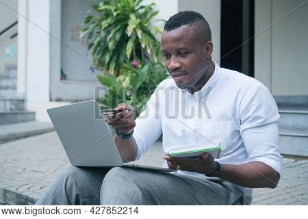 Portrait Happy African American Young Man Smiling Confident Optimistic Sitting Communication Video C