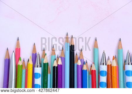 Pencil On White Background And Back To School. Items For The School, Office Equipment On Table Backg
