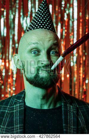 Birthday Party. Funny Man. Holiday Fun. Enjoying Celebration. Happy Bearded Guy Wearing Festive Hat