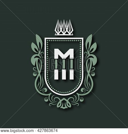 Vintage Premium Monogram Of Letter M. Heraldic Coat Of Arms In Form Of Shield Surrounded By Floral O
