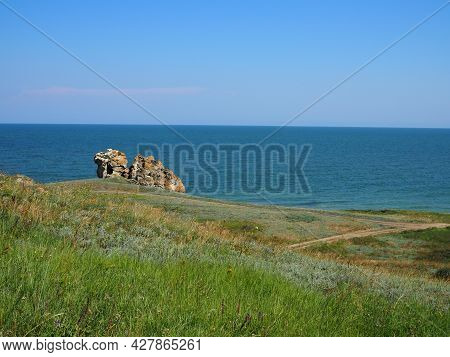 Rocky Hills And The Seashore On A Sunny Summer Day. Mountain That Looks Like A Camel.