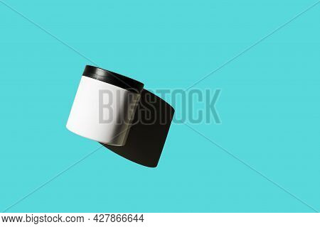 Advertising Isolated Container On Bright Sunny Light Blue Background. Skincare, Bodycare Beauty Prod