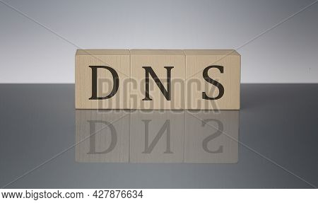 Dns Concept, Wooden Word Block On Grey Background