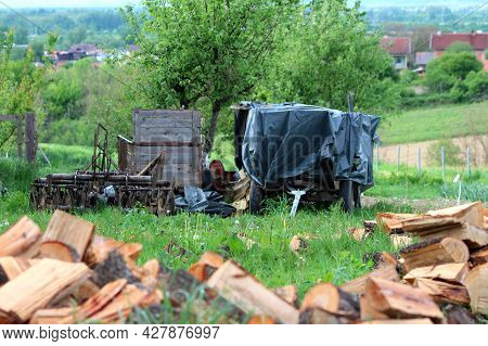 Old Rustic Vintage Dilapidated Wooden Tractor Trailers With Four And Two Wheels Covered With Thick N