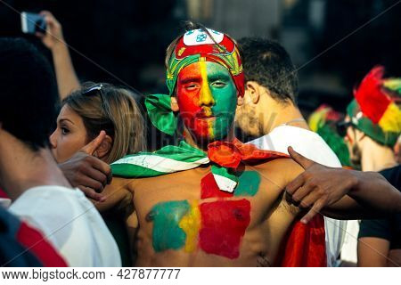 OPORTO, PORTUGAL - JUL 10, 2016: During video translation of the football match Portugal - France final of the European championship 2016, Portuguese fans in the Porto city center.