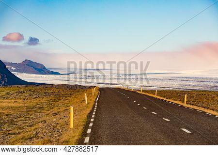 Empty Route 1 Ring Road In Barren Landscape Near Jokulsarlon With Great View Of Vatnajokull Glacier