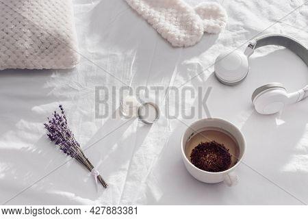 Aromatic Herbal Tea To Help You Falling Asleep. Sleep Mask, Aroma Balsam, Dry Lavender Flowers On Wh