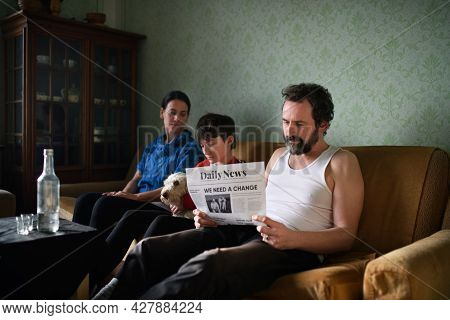 Portrait Of Poor Mature Couple With Small Daughter And Dog Indoors At Home, Poverty Concept.