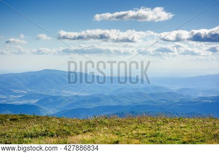 Grassy Mountain Hills In Evening Light. Beautiful Scenery With Clouds On The Blue Sky. Wonderful Nat